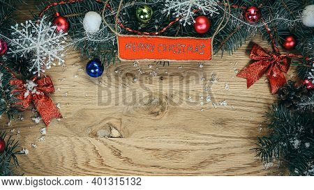 Christmas Wreath With A Congratulatory Inscription On A Wooden B