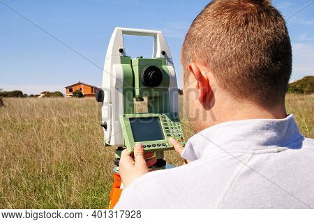 Man Using Of Total Station. Guy Surveyor At Work. Survey Instrument Geodetic Device, Total Station S
