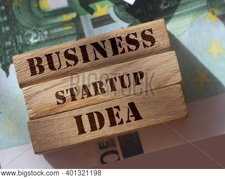 Wooden blocks with the words Business Startup Idea. The concept of raising funds for startup,Crowdfunding. Investing in the future.