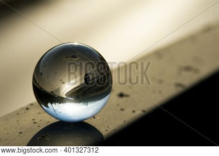 A Highway View Through A Lens Ball. Glass Ball With Inverted Street View. Lens Ball Photography.