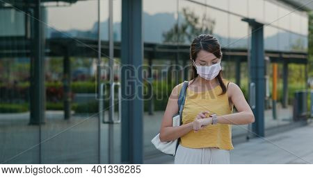 Woman use of smart watch at outdoor park