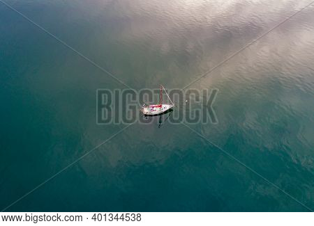 Lone Sailboat On The Puget Sound From Olympia, Washington