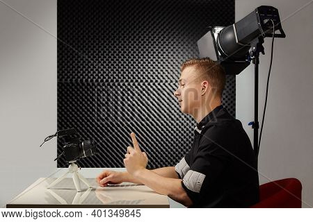 Young Vlogger During Process Of Streaming His Video To Public