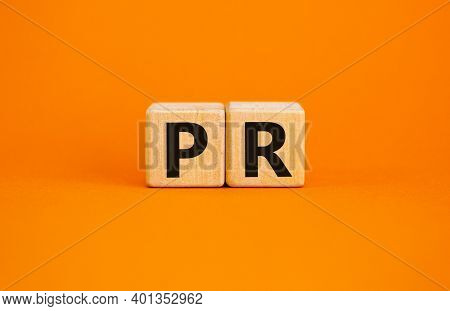 Pr - Public Relations Symbol. Wooden Cubes With Words 'pr, Public Relations' On Beautiful Orange Bac