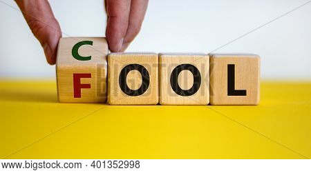 Do Not Be A Fool Just Play Cool Symbol. Male Hand Turns Wooden Cubes And Changes The Word 'fool' To