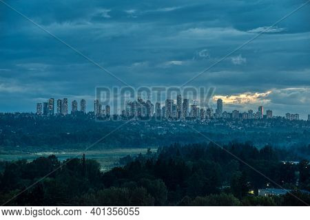 Overview Of Metrotown Cityscape On Cloudy Sky Background