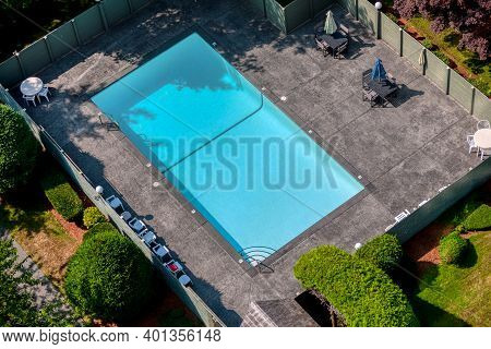 Outdoor Swimming Pool With Emerald Water And Recreation Area Around