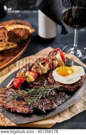 Grilled Meat Platter. Assorted Delicious Grilled Meat With Vegetables. Grilled Mixed Meat With Peppe