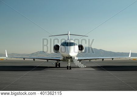 Private Jet Sitting On Runway Waiting To Be Boarded