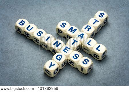 small business strategy crossword - financial planning concept