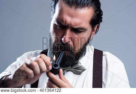Old Fashioned Bearded Hipster Smoke Pipe. Brutal Handsome Man With Moustache Smoking. Mature Busines