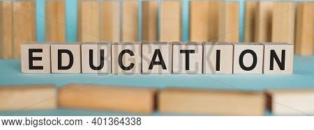 Education - Word From Wooden Blocks With Letters, Education Concept On Light Blue Background.