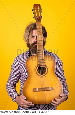 Male Guitarist With Musical Instrument. Country Music Concept. Bearded Man Play Acoustic Guitar. Cas