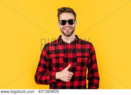Young Handsome Man In Checkered Shirt And Sunglasses Has Bristle On Face, Vacation