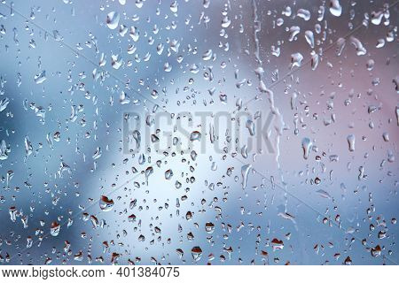Rain Droplets On Glass Over Calm Colorful Background. Abstract Backdrop.