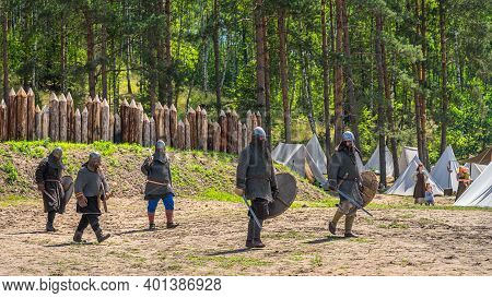 Cedynia, Poland, June 2019 Group Of Warriors In Chainmail Armour Going To War. Historical Reenactmen