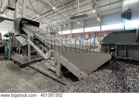Plastic Recycling Plant. Conveyor With Shredded Plastic From Pet Bottles.