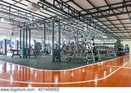 Many Equipment Or Tool In Modern Empty Gym With Indoor Running Track For Recreation Or Exercise Body