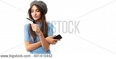 Girl With A Credit Card With Mockup And A Phone On A White Studio Background.