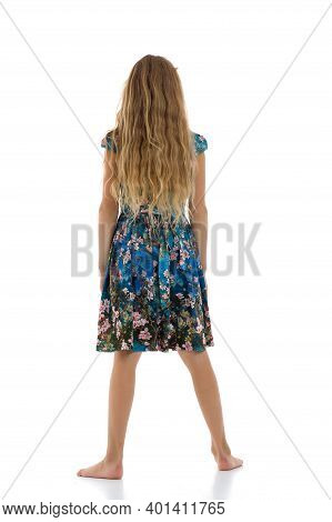 Rear View Of Teenage Blonde Girl With Long Hair. Full Length Portrait Of Blonde Girl In Summer Dress