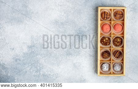 Set Of Chocolate Truffle Made Of Dark And Milk Chocolate With Orange Glaze, Strawberries (cranberrie