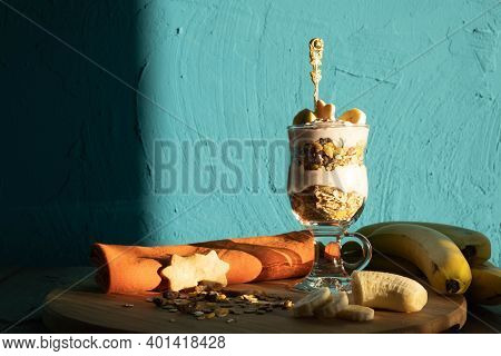 Cookies, Bananas, Fresh Yogurt And Muesli In A Glass And Muesli Sprinkled A Little On The Table, On