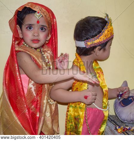 Cute Indian Kids Dressed Up As Little Lord Radha And Krishna On The Occasion Of Radha Krishna Janmas
