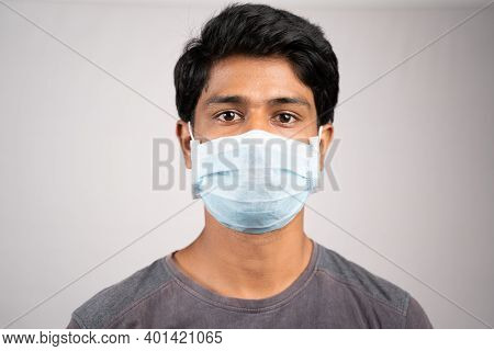 Young Man Properly Covered Nose And Mouth With Face Mask - Awareness And Safety Concept To Ware Mask