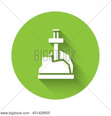 White Sword In The Stone Icon Isolated With Long Shadow. Excalibur The Sword In The Stone From The A