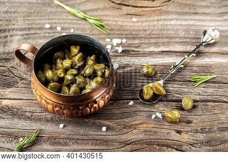 Pickled Capers. Canned Capers, Salted Capers In Vinegar On A Wooden Background, Banner, Menu Recipe