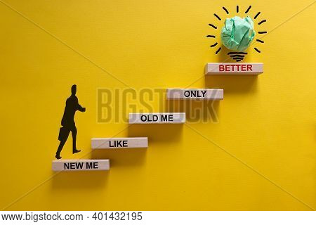 Better New Me Symbol. Wood Blocks Stacking As Step Stair On Yellow Background, Copy Space. Words 'ne
