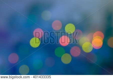Abstract Background Of Defocused Christmas Lights On Christmas Tree