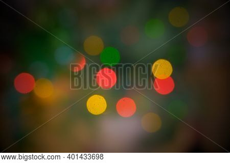 Blurred Background Of Defocused Christmas Lights On Christmas Tree.