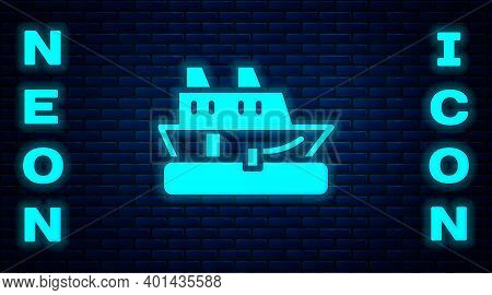Glowing Neon Cruise Ship Icon Isolated On Brick Wall Background. Travel Tourism Nautical Transport.