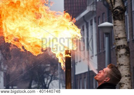 Kampen, The Netherlands Dec 31 2016 Man Spitting Fire During New Years Eve