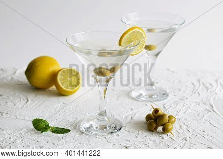 Alcohol Drinks. Margarita Cocktail In The Bar. Two Martini Glasses Of Cocktail With Green Mint And O