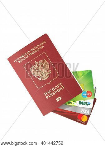 Moscow, Russia, December 31, 2020: Russian Passport And Credit Cards Of The Maestro Systems, Russian