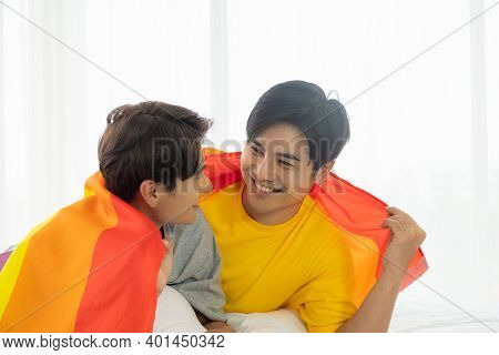 Selective Focus At Face. Handsome Young Asian Gay Homosexual Couple. Hug And Embrace On The Bed. Wit