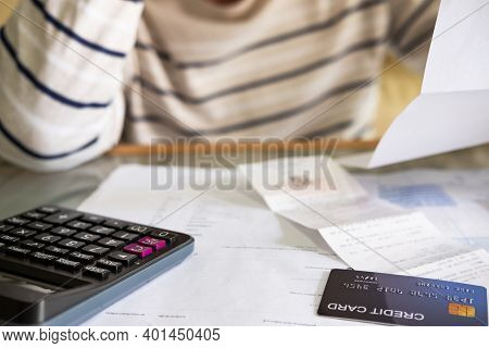Selective Focus At Credit Card Mock Up. Close Up Shot Of People Who Check Financial Invoice And Inco