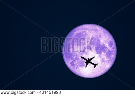 Full Crow Moon And Silhouette Airplane Flight On Night Sky