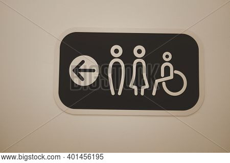 A Restroom Sign Toilet Male Female And Cripple Public On Wall
