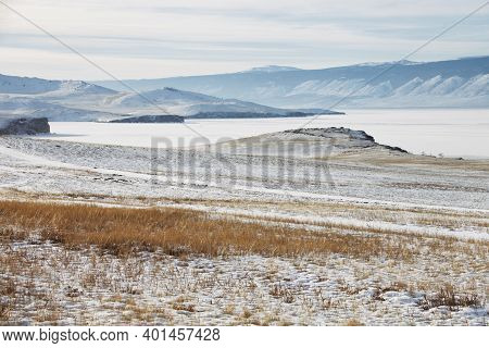 Grass And Snow On Olkhon Island. Winter Landscape