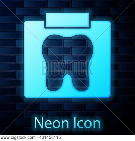 Glowing Neon X-ray Of Tooth Icon Isolated On Brick Wall Background. Dental X-ray. Radiology Image. V