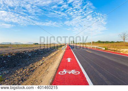 Bicycle Sign Path On Road, Bikes' Lane On Outskirts Or Urban Area. Bicycle Lane Signage On Street.