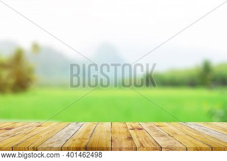 Shelf Of Brown Wood Plank Board With Blurred Green Rice Field Farm With Mountain And Hut Nature Back