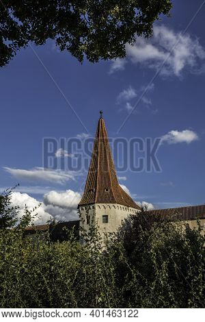 Peaky City Wall Tower With Trees And The Blue Cloudy Sky