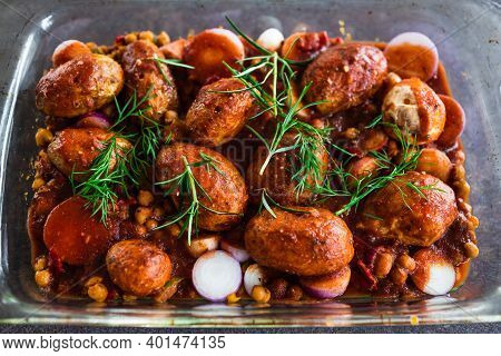 Plant-based Food, Vegan Potato And Onion Roast With Chickpeas Tomato Sauce And Herbs