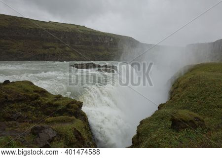 People Visiting And Experiencing The Power Of Popular Tourist Destination - Gullfoss Waterfall On Hv