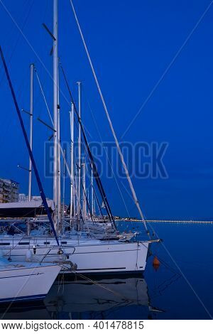 Scenic View Of The Yachts Moored In The Port Of Volos Under The Blue Night Sky, Greece.