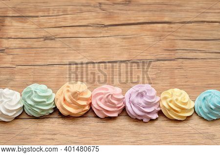 A Row Of Meringues On A Table